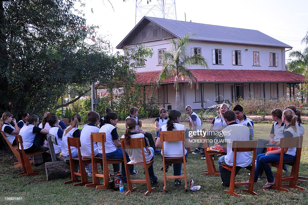 Mennonites students take part in a class outside the mennonite museum in Filadelfia, Paraguay on November 3, 2012. Mennonites celebrate this year the 85 anniversary of their first immagration to Paraguay from Russia and GermanyAFP PHOTO/Norberto Duarte