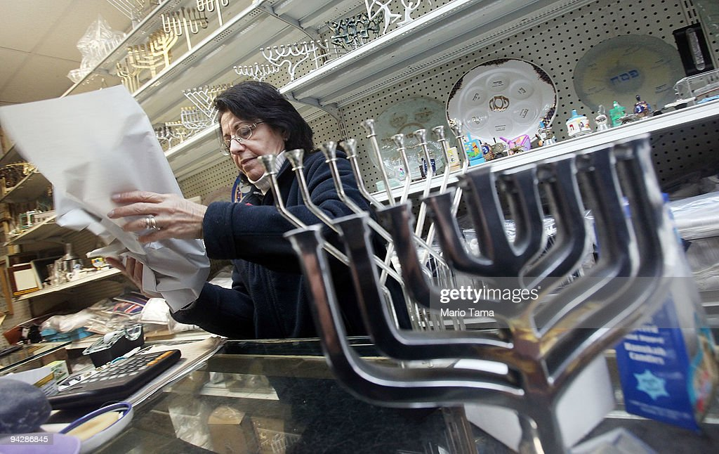 Menorahs are seen for sale in a Lower East Side shop that sells Jewish items on the first day of Hanukkah December 11 2009 in New York City Once the...