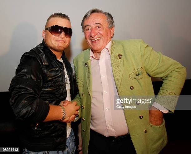 Menowin Froehlich and Richard Lugner attend a press conference at Lugner City on May 10 2010 in Vienna Austria