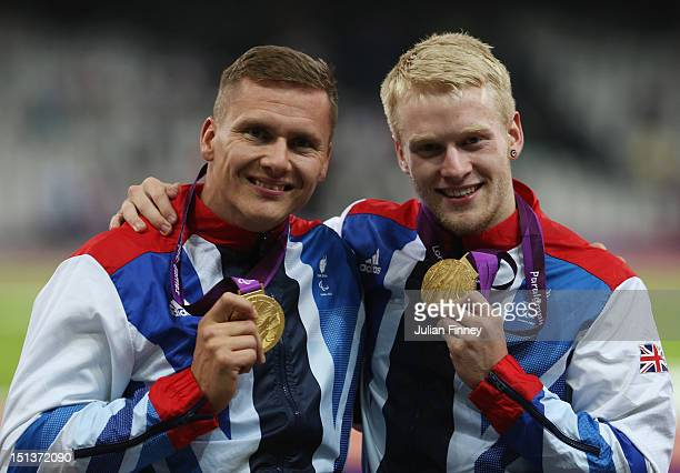 Men's 800m T54 Gold medalist David Weir of Great Britain and Men's 100m T44 Gold medalist Jonnie Peacock of Great Britain pose on day 8 of the London...