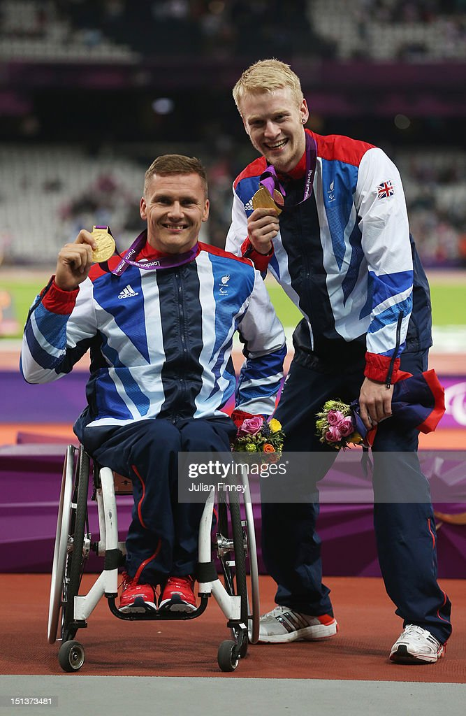 Men's 800m - T54 Gold medalist David Weir of Great Britain and Men's 100m - T44 Gold medalist <a gi-track='captionPersonalityLinkClicked' href=/galleries/search?phrase=Jonnie+Peacock&family=editorial&specificpeople=7441025 ng-click='$event.stopPropagation()'>Jonnie Peacock</a> of Great Britain pose on day 8 of the London 2012 Paralympic Games at Olympic Stadium on September 6, 2012 in London, England.