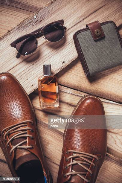 Men's accessories organized on wooden table