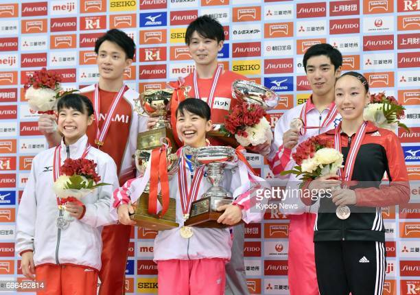 Men's allaround gymnastics national title winner Kohei Uchimura poses with secondplace Yusuke Tanaka and thirdplace Kenzo Shirai at Tokyo...