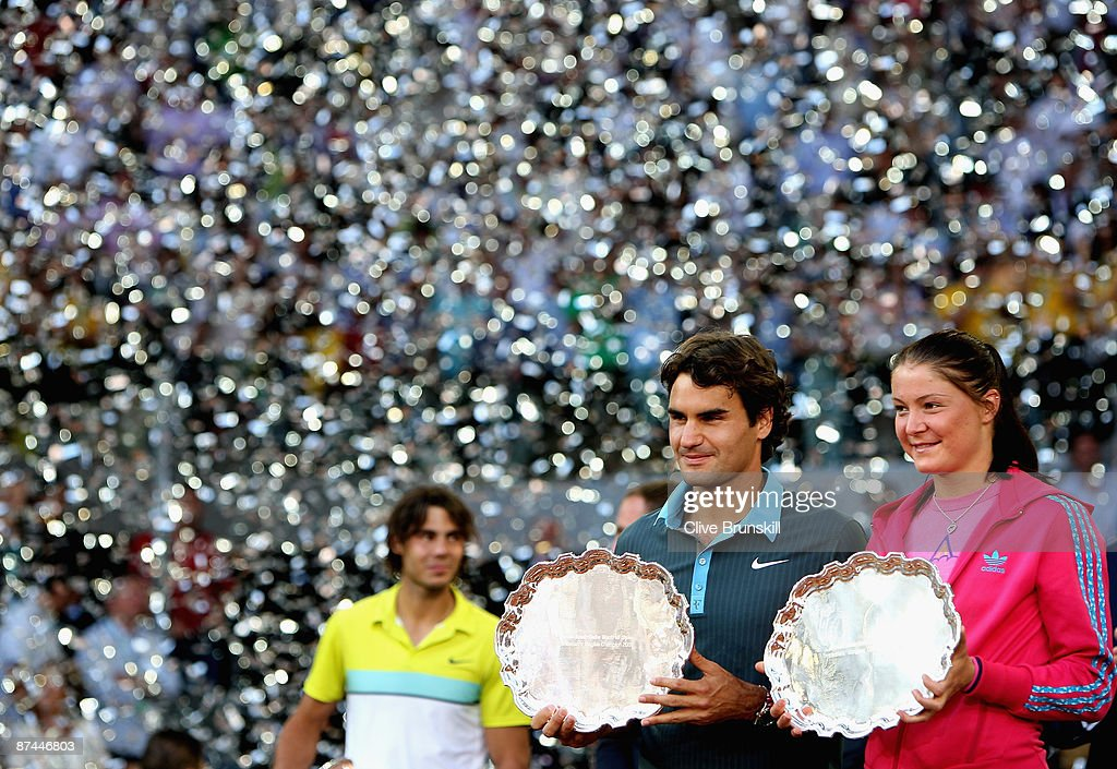 Mens and womens champions Dinara Safina of Russia and Roger Federer of Switzerland pose for photographs during the prize giving ceremony during the Madrid Open tennis tournament at the Caja Magica on May 17, 2009 in Madrid, Spain.