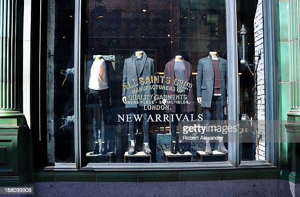 Men's and women's fall and winter fashions in a window display at the Allsaints store in San Francisco's upscale Union Square shopping district Also...