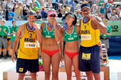 Men's and women's gold medallists Brazil's Alvaro Filho China's Chen Xue and Zhang Xi and Brazil's Ricardo Santos pose after winning the FIVB Gstaad...