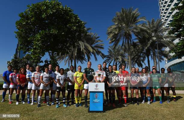Men's and women's team captains pose for photos with the Rugby World Cup Sevens Trophies during the Emirates Dubai Rugby Sevens HSBC Sevens World...