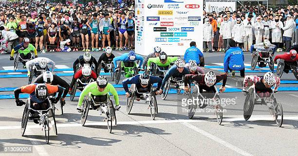 Men's and women's wheelchair runners start the Tokyo Marathon 2016 in front of the Tokyo Metropolitan headquarters on February 28 2016 in Tokyo Japan