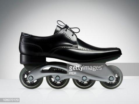 Men's black business shoe with rollerblade wheels