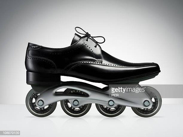 Men's black business shoe with rollerblade wheels