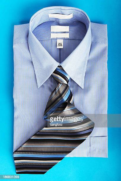 Men's blue shirt and tie folded