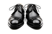Black leather men's dress shoes isolated on white