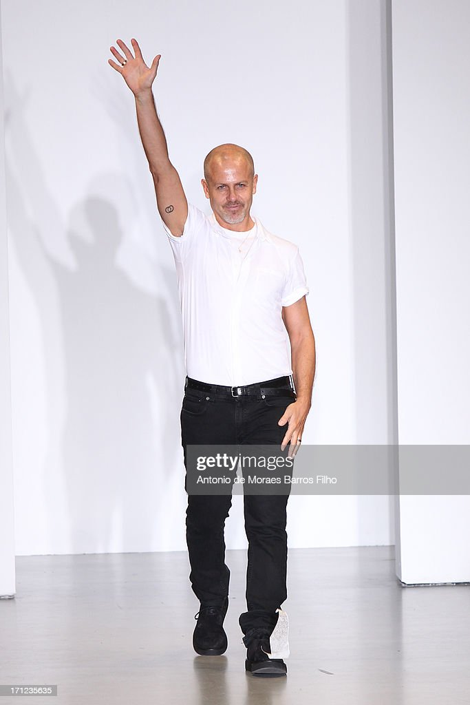 Men's Creative Director for Calvin Klein Italo Zucchelli acknowledges the audience during the Calvin Klein show as a part of Milan Fashion Week S/S 2014 on June 23, 2013 in Milan, Italy.