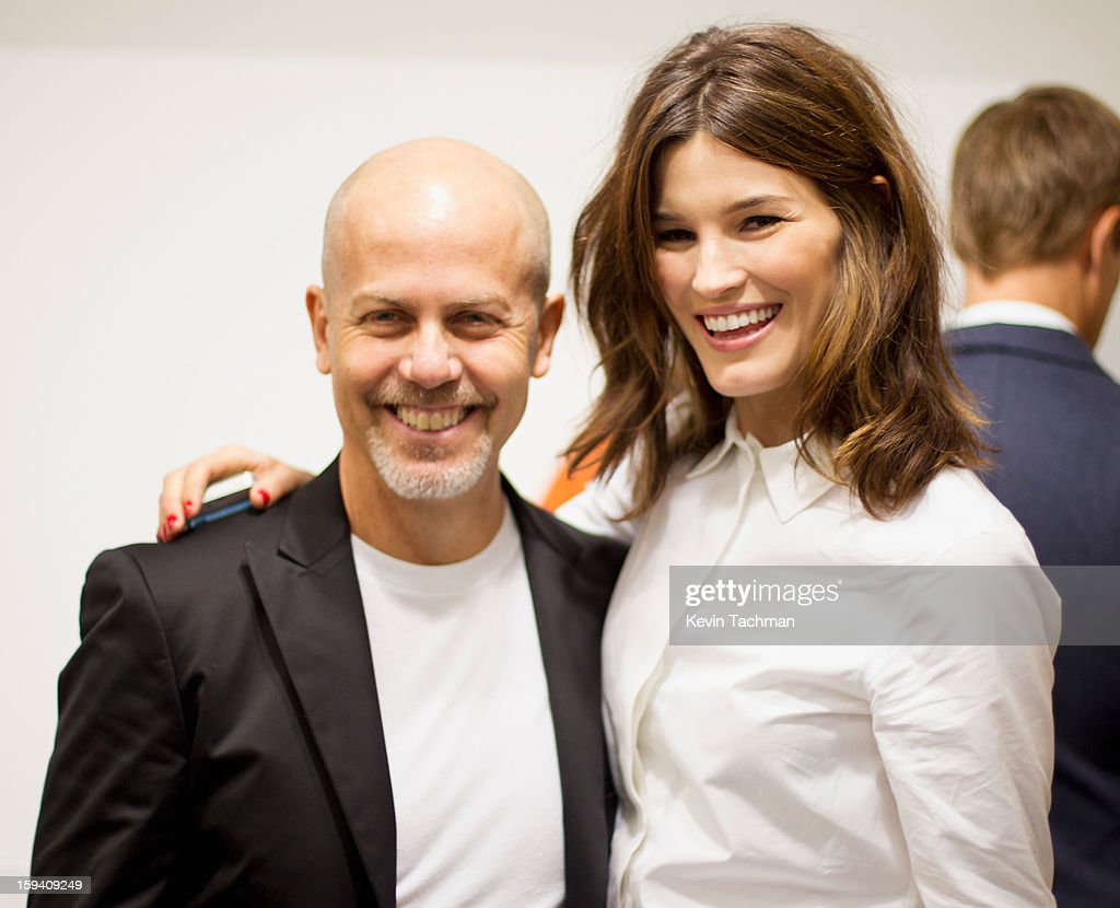 Men's Creative Director of Calvin Klein Collection Italo Zucchelli (L) and fashion blogger Hanneli Mustaparta pose backstage prior to the Calvin Klein Collection show as part of Milan Fashion Week Menswear Autumn/Winter 2013 on January 13, 2012 in Milan, Italy.