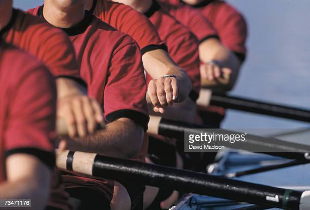 Men's crew team rowing in unison, close-up