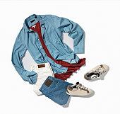 Men's denim shirt, pants with sneakers isolated on white background (with clipping path)