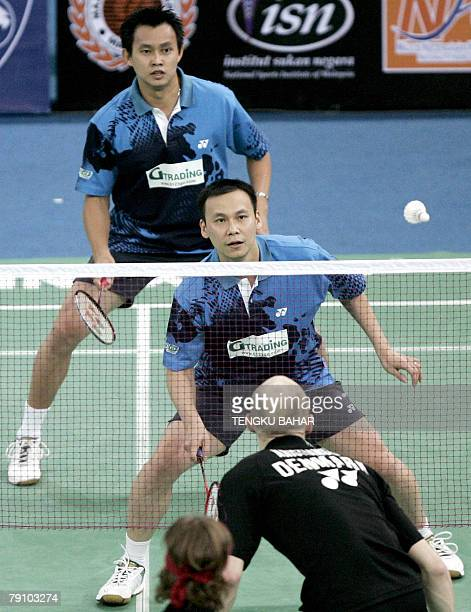 Men's doubles pair Candra Wijaya of Indonesia and Tony Gunawan of the US are all eyes on the shuttlecock as they challenge Denmark's Simon Mollyhus...