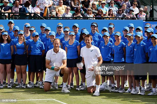 Men's doubles winners Dominic Inglot of Great Britain and Daniel Nestor of Canada pose with their trophies during day six of the ATP Aegon Open...