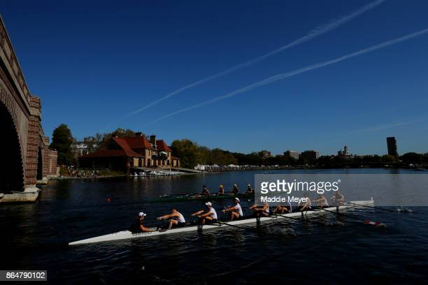 Men's Eights teams row past the Weld Boathouse during the Head of the Charles Regatta on October 21 2017 in Boston Massachusetts
