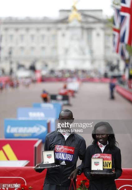 Men's elite winner Kenya's Daniel Wanjiru and Women's elite winner Kenya's Mary Keitany pose after the London marathon on April 23 2017 in London /...