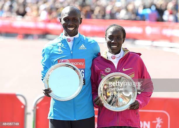 Men's Elite winner Wilson Kipsang of Kenya and Women's Elite winner Edna Kiplagat of Kenya pose for photos after the Virgin Money London Marathon on...