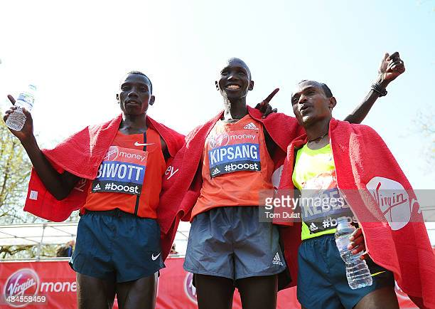 Men's Elite winner Wilson Kipsang of Kenya poses with second placed Stanley Biwott of Kenya and third placed Tsegaye Kebede of Ethiopia following the...