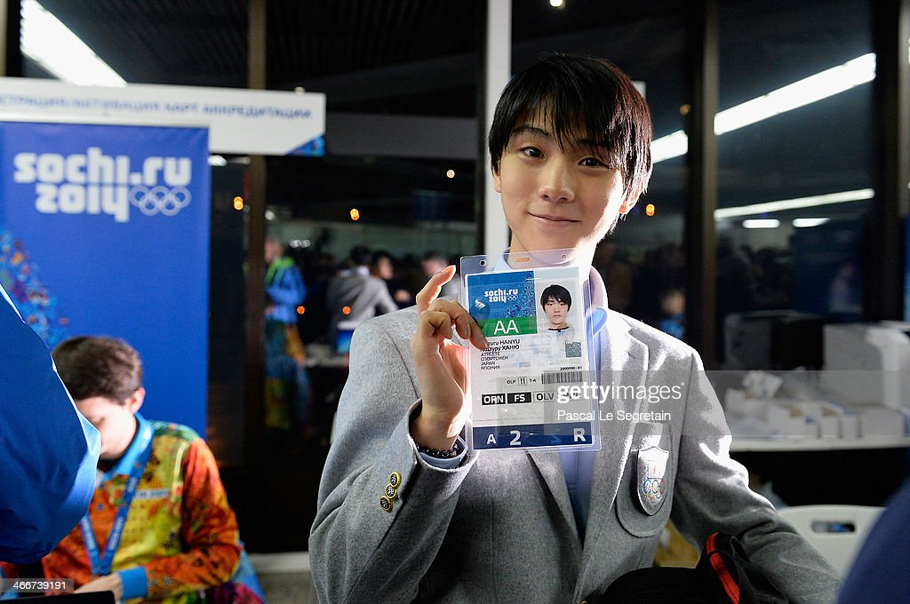 Men's figure skater Yuzuru Hanyu of Japan shows his accreditation as he arrives at Sochi International Airport ahead of the Sochi 2014 Winter Olympics on February 3, 2014 in Sochi, Russia.