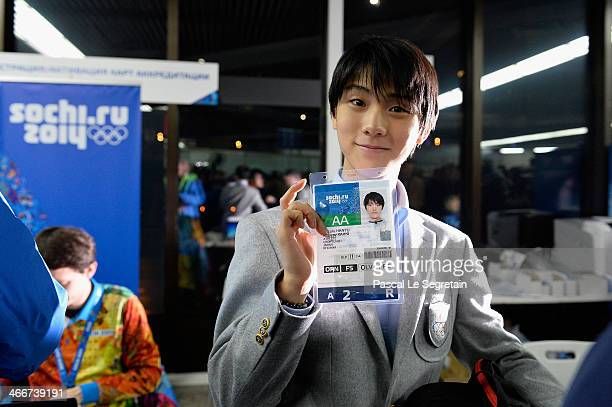 Men's figure skater Yuzuru Hanyu of Japan shows his accreditation as he arrives at Sochi International Airport ahead of the Sochi 2014 Winter...