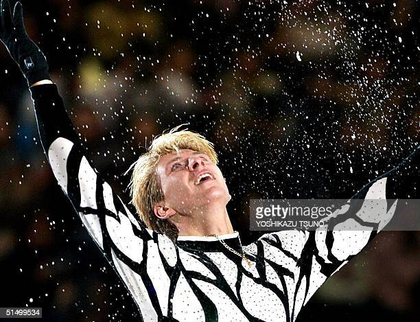 Men's gold medalist Alexei Yagudin of Russia throws ice dusts in the air during the winners' exhibition program of the World Figure Skating...