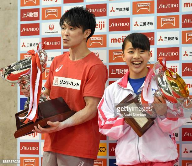 Men's gold medalist Kohei Uchimura and women's gold medalist Mai Murakami pose on the podium at the medal ceremony during day three of the All Japan...