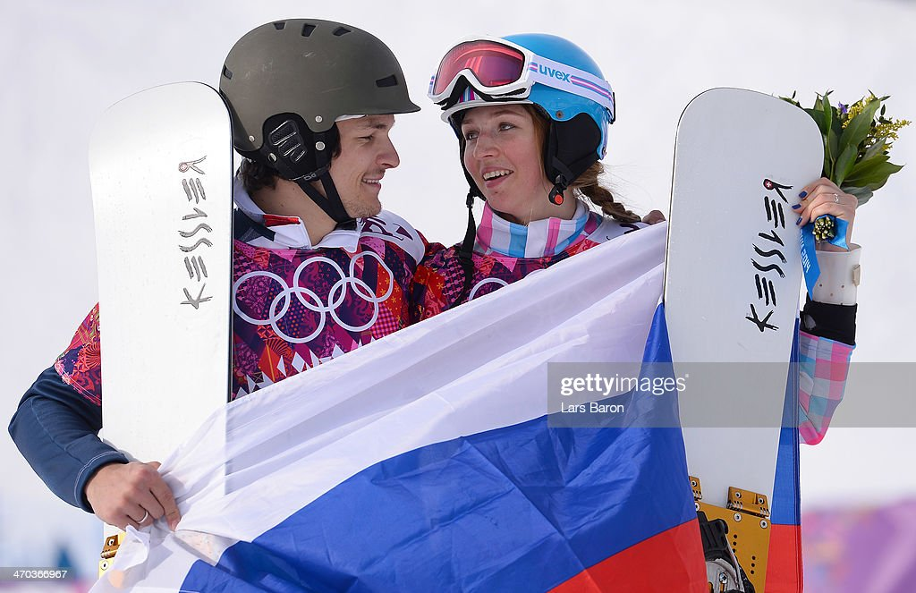 Men's gold medalist <a gi-track='captionPersonalityLinkClicked' href=/galleries/search?phrase=Vic+Wild&family=editorial&specificpeople=6691731 ng-click='$event.stopPropagation()'>Vic Wild</a> of Russia and women's bronze medalist <a gi-track='captionPersonalityLinkClicked' href=/galleries/search?phrase=Alena+Zavarzina&family=editorial&specificpeople=6598104 ng-click='$event.stopPropagation()'>Alena Zavarzina</a> of Russia celebrate after the Snowboard Parallel Giant Slalom Finals on day twelve of the 2014 Winter Olympics at Rosa Khutor Extreme Park on February 19, 2014 in Sochi, Russia.