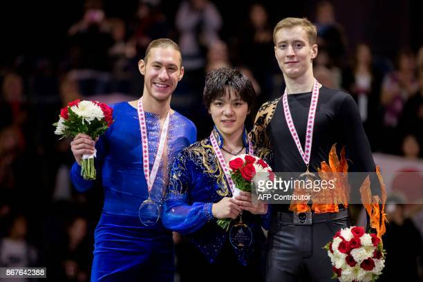Men's gold medalists Shoma Uno of Japan poses with silver medalist Jason Brown of the United States and bronze medalist Alexander Samarin of Russia...