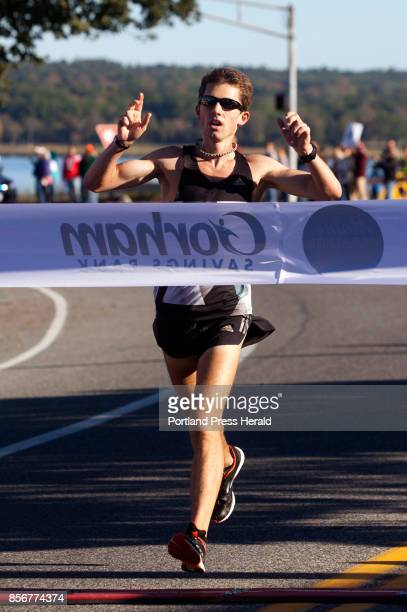 Men's half marathon winner Jonny Wilson of Falmouth crosses the finish line during the Maine Marathon in Portland on Sunday October 1 2017