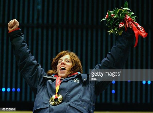 Men's Halfpipe gold medalist Shaun White celebrates during the Medal Ceremony on Day 2 of the Turin 2006 Winter Olympic Games at the Medals Plaza on...