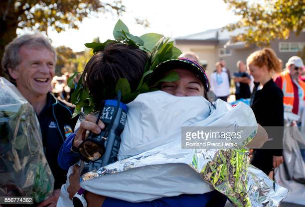 Men's marathon winner Andrew Van Hoogenstyn of New Haven Connecticut hugs his partner Hayley Germack of New Haven Connecticut after the Maine...