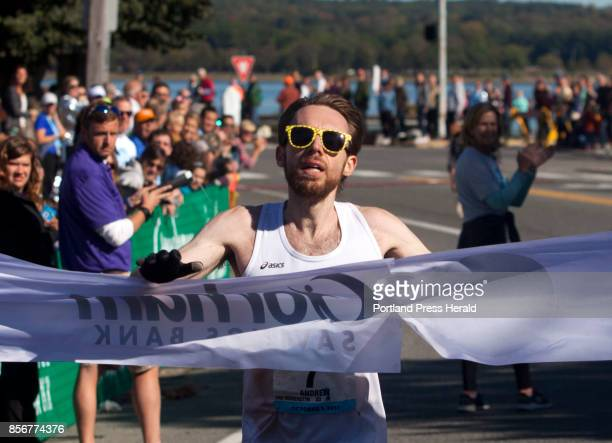 Men's marathon winner Andrew Van Hoogenstyn of New Haven Connecticut crosses the finish line during the Maine Marathon in Portland on Sunday October...
