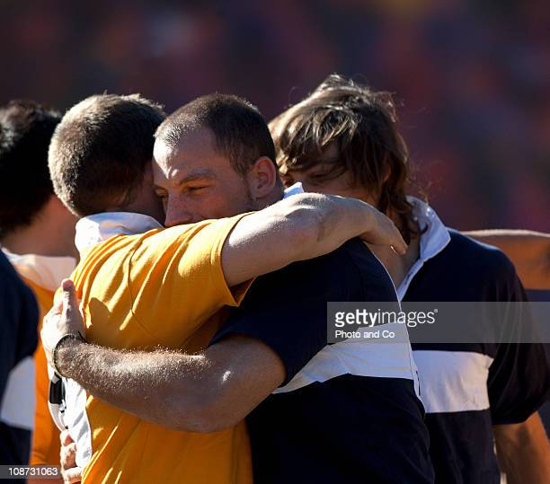 Mens Rugby Match Giving Hug afterward