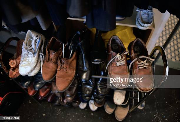 Men's shoes are on display at a 'boutique' that gives away donated crisp business clothes to those who on Mexico's September 19 quake lost everything...