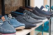 Men's Shoes on Shelf in Store
