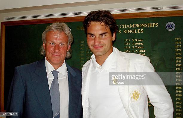 Men's singles champion Roger Federer of Switzerland poses with former champion Bjorn Borg in the members area at the All England Lawn Tennis and...