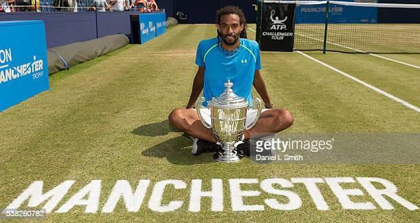 Mens Singles winner Dustin Brown of Germany poses with his trophy during the Aegon Manchester Trophy at the Northern Lawn Tennis Club on June 5 2016...