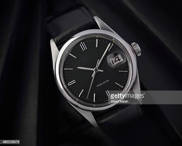 Mens stainless steel wristwatch with black face
