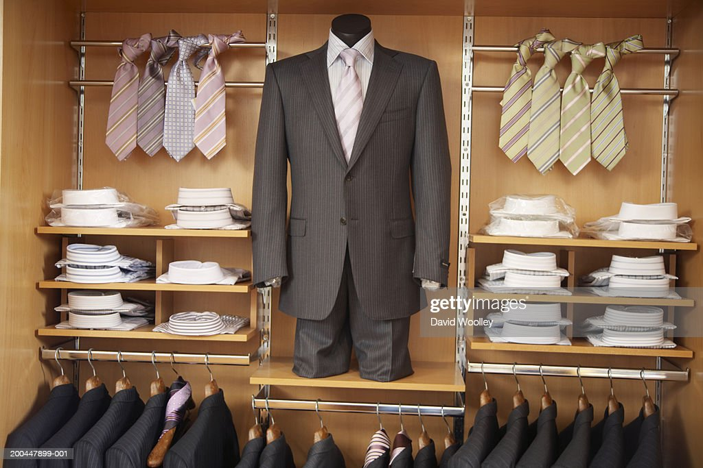 Mens' suits, shirts and ties in store display : Stock Photo