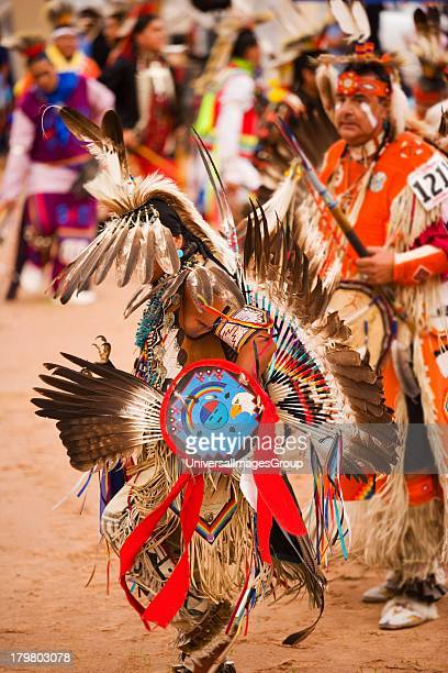 Mens traditional dancers in Grand Entrance of powwow Gallup InterTribal Indian Ceremonial Gallup New Mexico