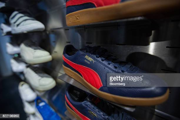 Mens trainers sit on display inside a Puma SE sportswear clothing store in Berlin Germany on Tuesday July 25 2017 Puma increased its fullyear...