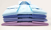 Some colored man shirts folded on white background