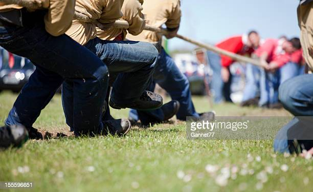 Men's tug of war contest in sunny field