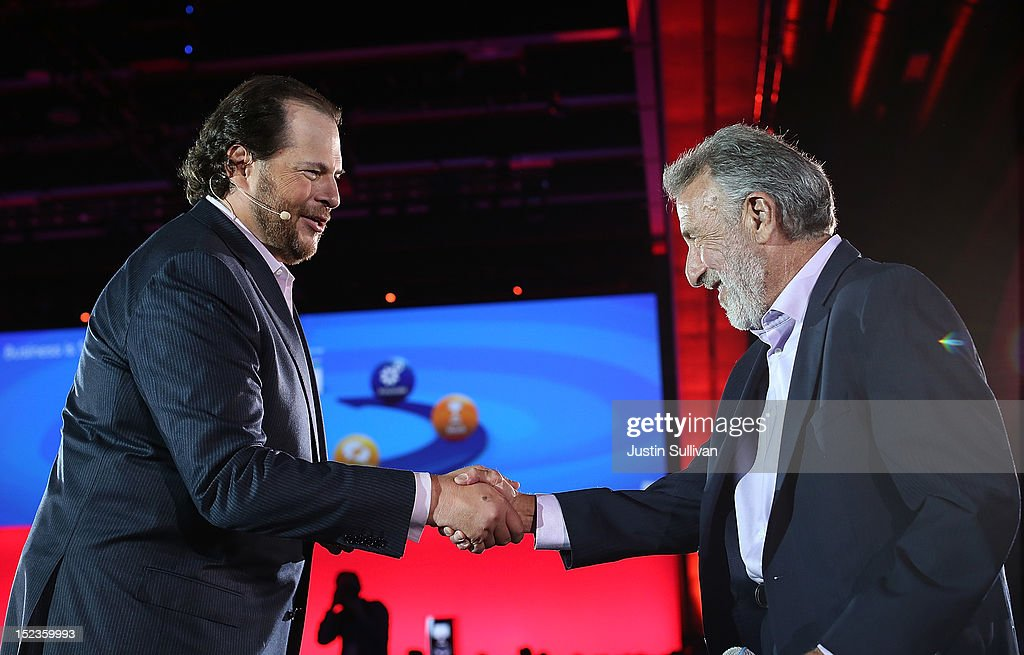 Mens' Wearhouse founder and CEO George Zimmer (R) shakes hands with Salesforce CEO Marc Benioff as he delivers the keynote address during the Dreamforce 2012 conference at the Moscone Center on September 19, 2012 in San Francisco, California. A reported 90,000 people registered to attend the cloud computing industry conference Dreamforce 2012 that runs through September 21.