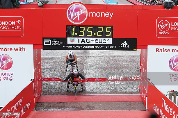 Men's wheelchair winner Marcel Hug of Switzerland crosses the line during the Virgin Money Giving London Marathon at the finish on The Mall on April...