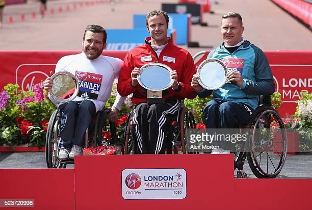 Mens wheelchair winner Marcel Hug of Switzerland second place Kurt Fearnley of Australian and third place David Weir of Great Britain after the...